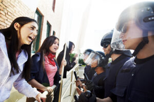 Protesters argue with police