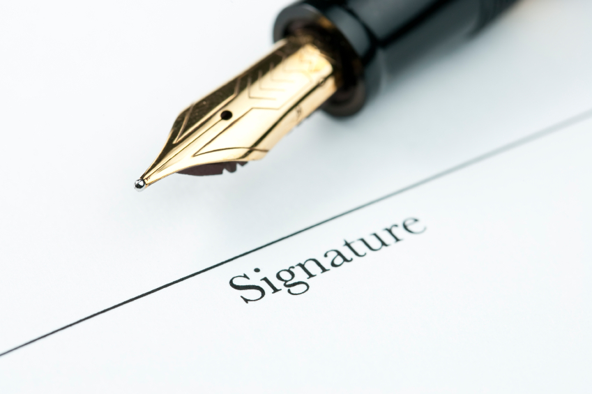 Gold Pen With Petition Signature Line Of Document